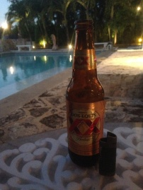 Cooling down with a Mexican XX beer at cozumel by the pool