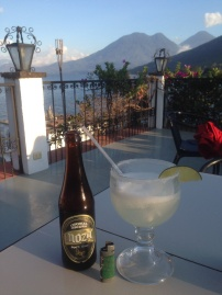Enjoying the views of Lake Atitlan in Guatemala with a margarita and cerveza